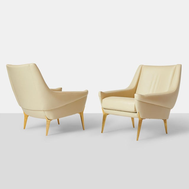 A rare set of lounge chairs in ivory leather with tapered gilt metal legs. Edited by Castellaneta