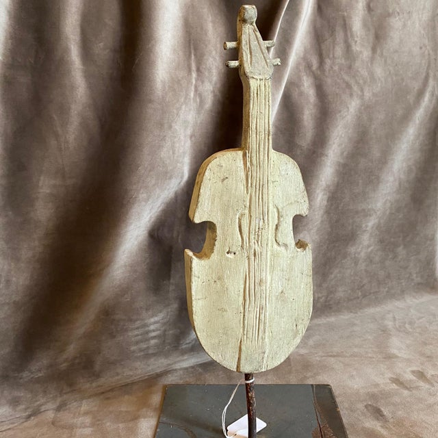 18th Century Ancient wooden fragment on an iron base depicting a guitar