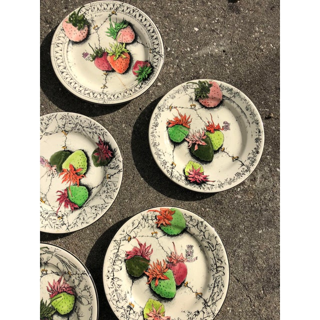 Set of five vintage ceramic dinner plates by the French company Gien. This is from the Fraises en Folie line of strawberry...