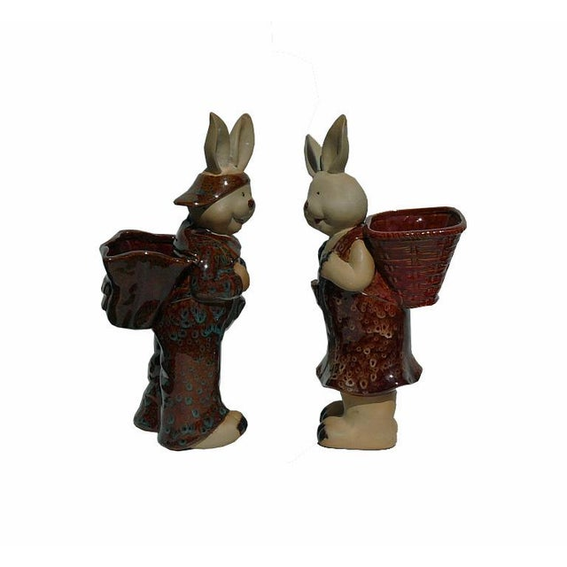 Handmade pair ceramic rabbit figure carry basket on back, this is a great decorative statue for home and office....