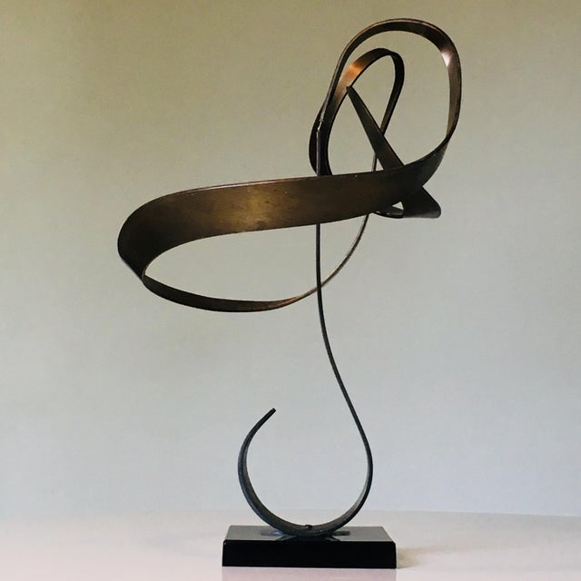 Kinetic sculpture by John W Anderson. Labeled and dated 1974 on underside. Made of not often seen brass (aluminum is more...