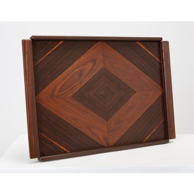 A rosewood tray by Don Shoemaker for Señal, designed and produced in Mexico. This example features an inlay pattern that...