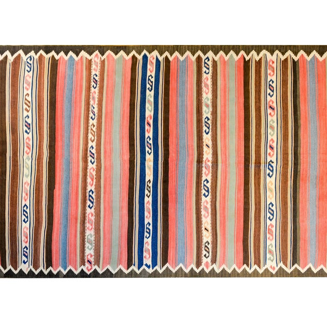 A wonderful early 20th century Persian Shahsevan Kilim runner with alternating boldly colored multicolored stripes of...