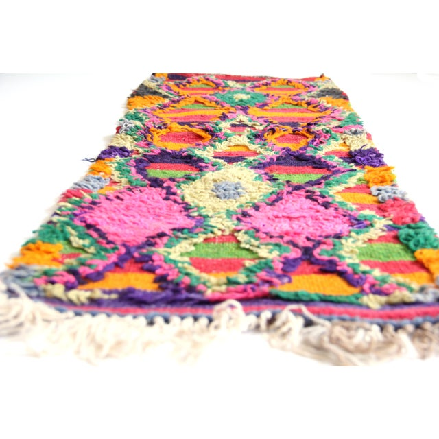 This bright and colorful, one-of-a-kind vintage Ait Bou Ichawouen carpet is an extremely rare and unique textile found in...