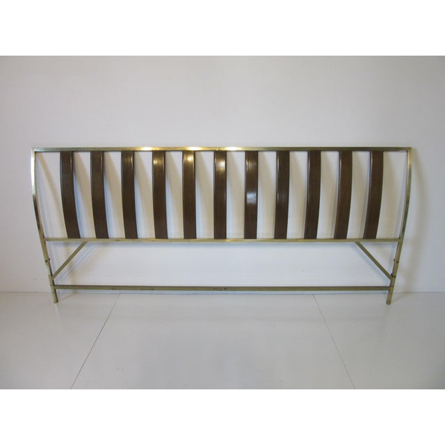 A square brass frame with gently curved dark mahogany slats to the headboard, the lower area attaches to your existing...