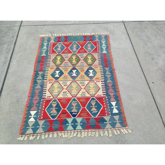 Handwoven kilim/rug with traditional patterns and beautiful colors. 100% natural wool, natural dyes. 50 years old....