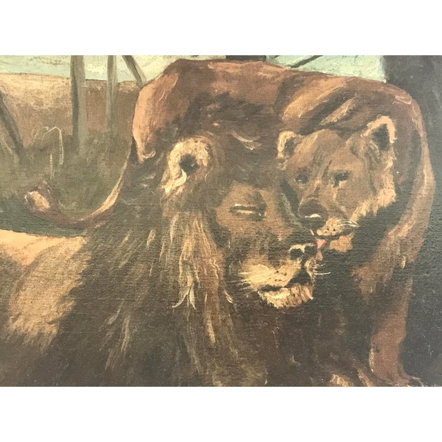 Antique oil painting of lion and lioness on board. The painting has been put on a canvase and nailed to boards to hang....