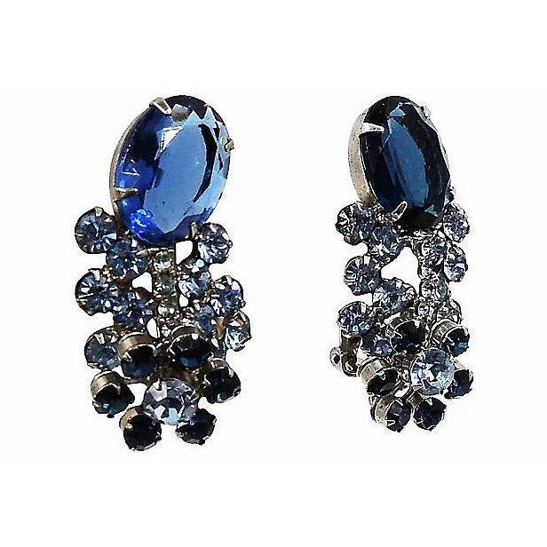 1960s silvertone unfoiled open-backed faux-sapphire earrings with round faux-sapphire and faux-aquamarine rhinestone...