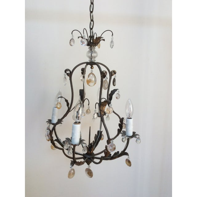Interesting and unusual small Chandelier with polished Quartz drops and a central upward spike in the middle for a candle...