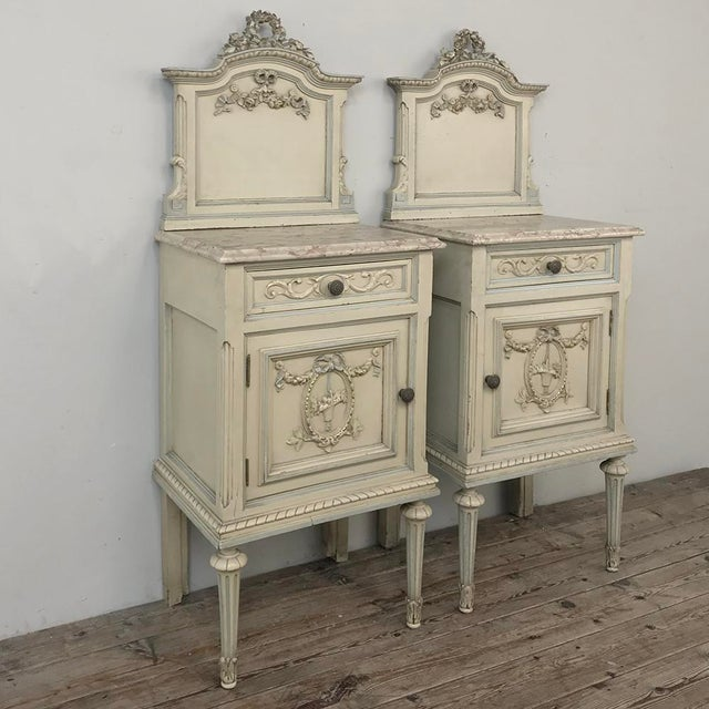 Pair Antique Italian Louis XVI Painted Nightstands are a mirror image pair of splendid end tables or bedside companions,...