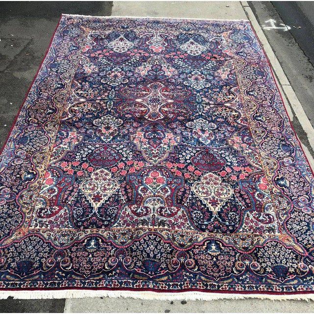 A finely woven monumental sized Kermin carpet in very nice condition with vibrant colors and an all-over design. Sure to...