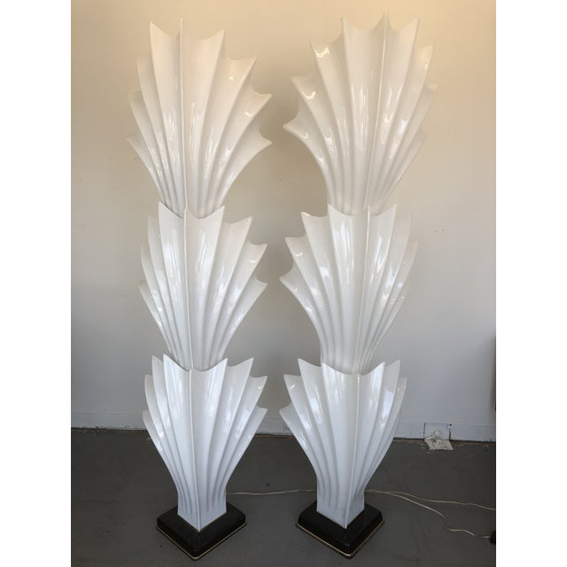 Elegant and show stopping, this hard to find pair is the first thing you see in any room. The bold shell form offers a...