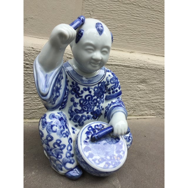1970's Asian baby buddha with drum figurine. Perfect to add to your collection. An adordable one of a kind piece.