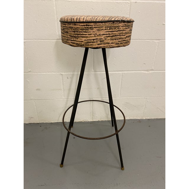 Excellent mid-century modern atomic era bar stool with drum tops. Vinyl upholstery and metal body. Original upholstery,...