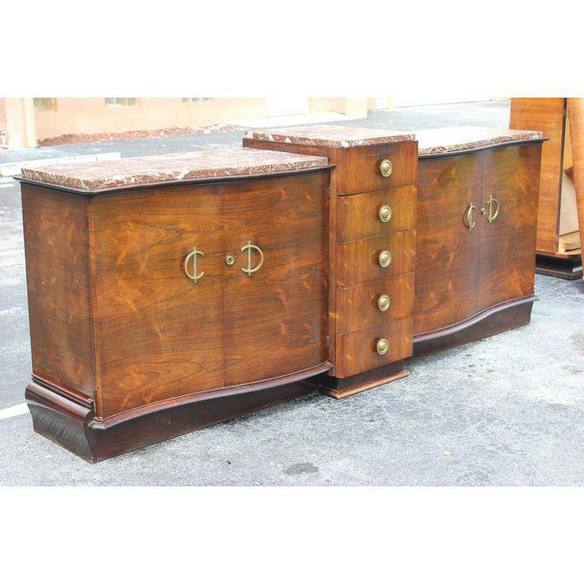 Classic French art deco grand scale exotic macassar ebony sideboard/buffet, circa 1940s. Center line of 5 drawers, the 3...