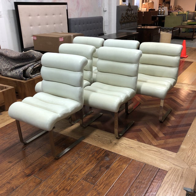 Design Plus Gallery presents Set of Six Midcentury Laguna Cantilever Dining Chairs. Designed by Frank Mariani for Pace...