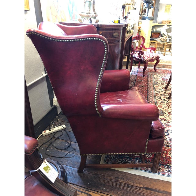 Everyone's favorite chair, this is a vintage yummy maroon cranberry leather wing chair by Hickory, big and gutsy with...