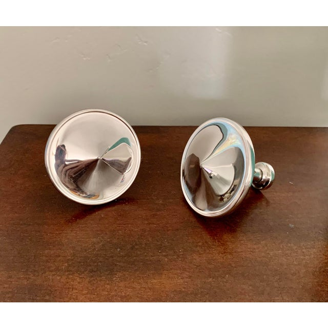Modern mobile silver plated set of salt and pepper shakers from famed French silver company Ercuis, named Upsilon, a...