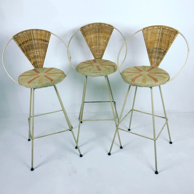 A very nice set of 3 Arthur Umanoff by Shaver Howard bar stools, with rattan backs. Rare white/cream coloured wrought iron...