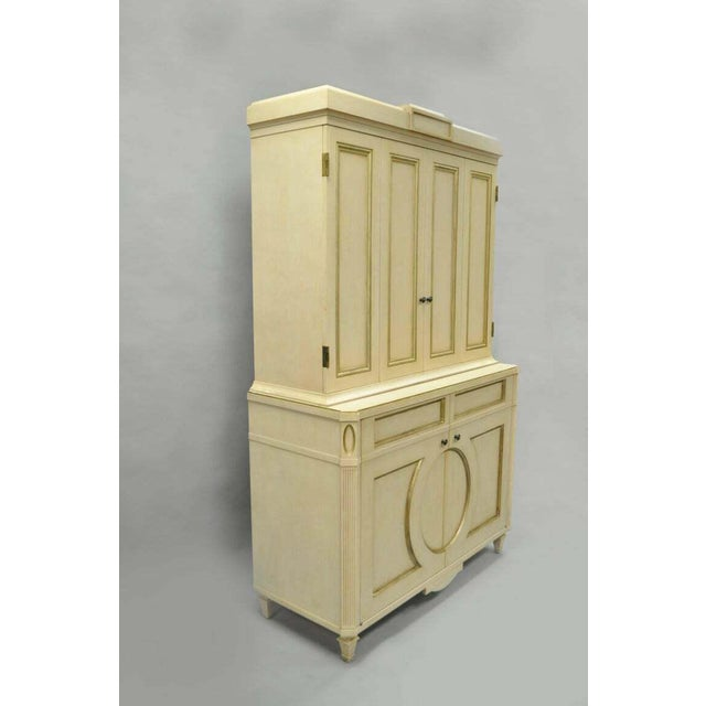 Large and impressive late 20th-century custom-made cream and gold distress painted cabinet by Decca in the French Louis...