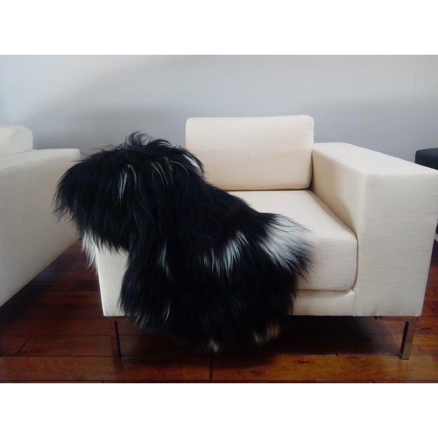 Brand new black and white long hair sheepskin. Very soft and durable. Use mild soap and water to spot clean when needed.