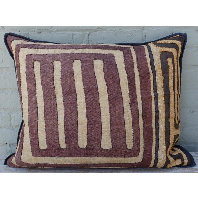 Large rectangular African Kuba Cloth Pillow The pillow is aubergine, tan & black with contrasting orange and black...