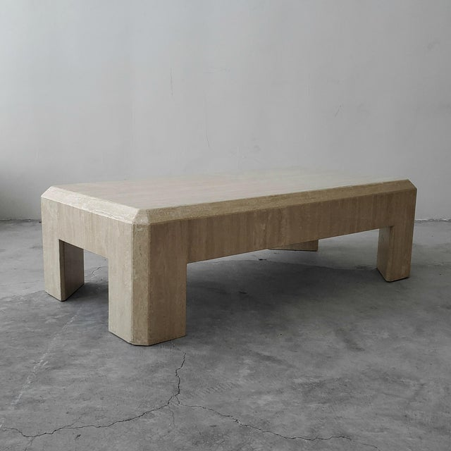 Beautiful and very substantial postmodern Italian travertine coffee table. Simple beautiful piece. A very modernist and...