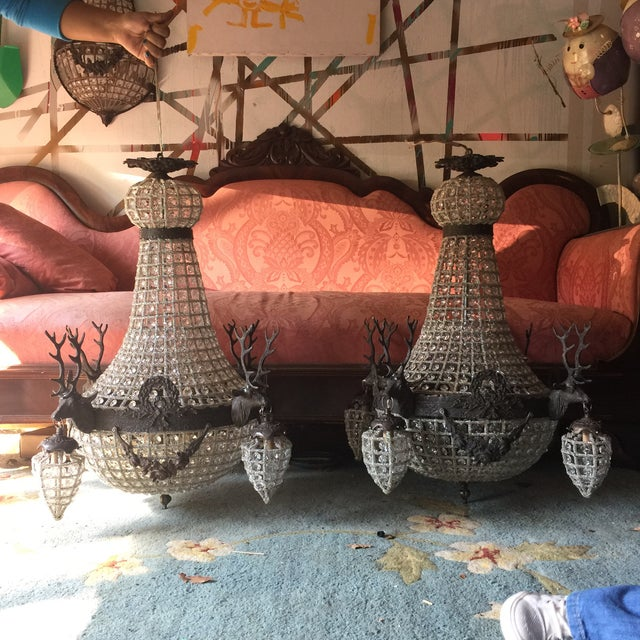 Gorgeous pair of deer stag chandeliers which boasts 10 lights (six on the inside and four on the outside). Ready to hang...