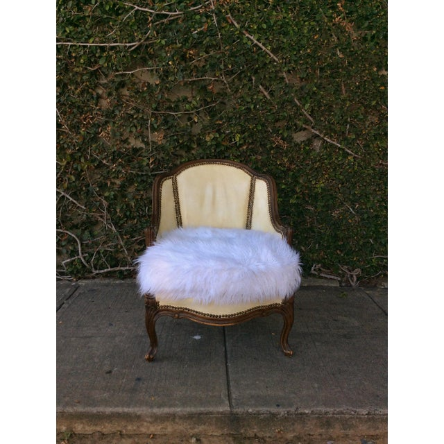 Vintage leather club chair updated with funky faux white Mongolian lamb fur seat. Very unique combo! Height to seat 18""