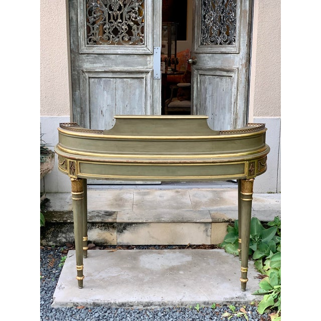 Antique painted French writing desk with parcel gilt and a leather top. This desk would be beautiful floated in a room or...