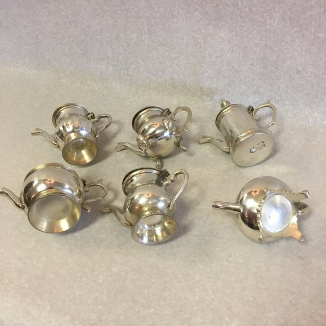 A set of 6 vintage reproduction tea pots, in the English style. Measurements are for each.