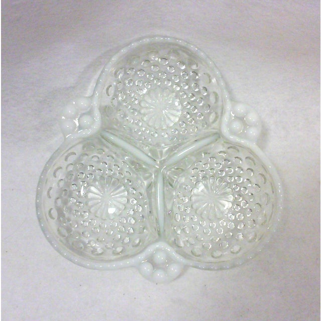 A lovely opalescent moonstone and clear glass hobnail clover leaf dish for serving or for decorative use. This vintage art...