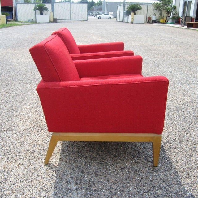 Two vintage Mid-Century lounge chairs by Heywood Wakefield. These chairs feature a stunning red colored fabric, with a...