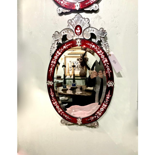 This is a superb pair of c. 1930-40 Art Deco Period Mirrors. The mirrors are detailed with an outline of etched cranberry...
