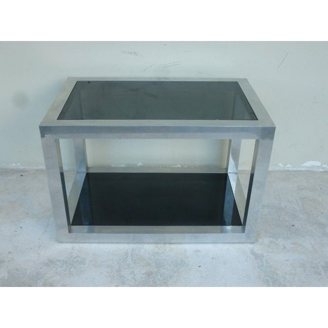 1970's Pace style aluminum rectangular table w black glass inserts sold as found measuring 31.75 inches long x 20 inches...