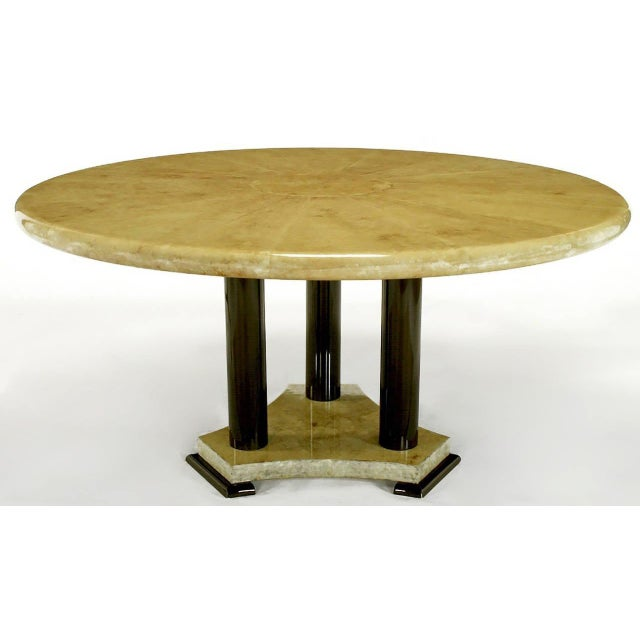 A stunning Empire style dining table, with a heavily lacquered goatskin top in a sunburst pattern. The top is supported by...