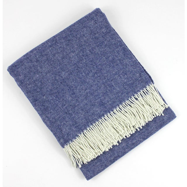Indigo herringbone throw is cashmere-soft and sophisticated with fresh white decorative fringe. Known for its light weight...
