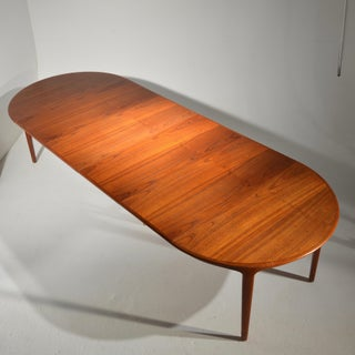 Extra Long Danish Teak Round Table With 4 Extensions by Henning Kjaernulf Preview