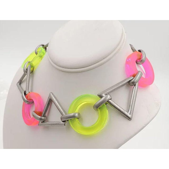 "Circa 1990 pewter tone with transparent yellow and pink neon Lucite links with toggle clasp. Marked ""Ben Amun."" Condition:..."