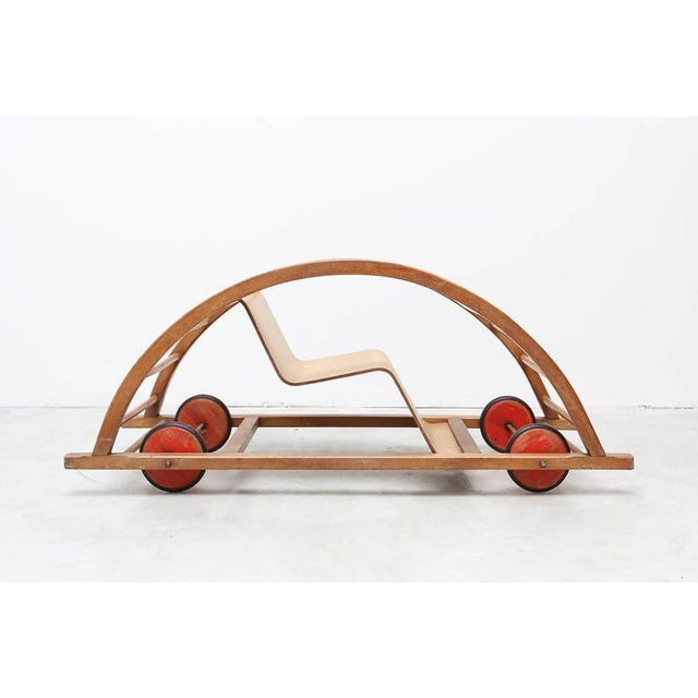 Car toy by Hans Brockhage and Erwin Andra made in the early 1950s DDR. Design Classic for kids. Beechwood frame, curved...