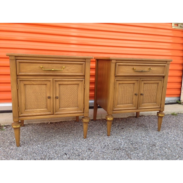 A pair of vintage, Hollywood Regency, solid walnut nightstands or end tables by White Furniture Company from 1970. The...