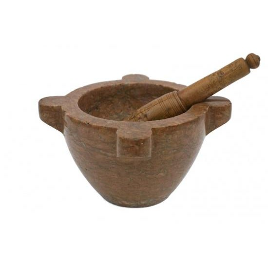 A 19th Century French rust colored marble mortar and wooden pestle.