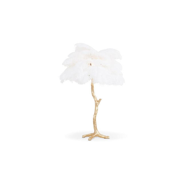 Contemporary Hollywood regency lamp with golden resin stem and white colored ostrich feathers. Decorative luxury piece...