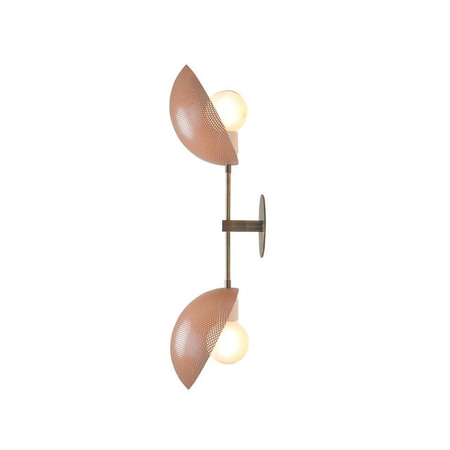 The AXIAL sconce conveys a strong modern design defined by balance and equilibrium. Axial features two bowl-shaped shades...