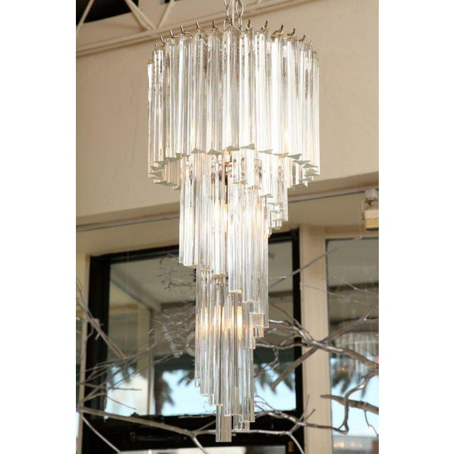 The play of tiers with this Italian Murano crystal prisms play fantastically with light. The glass hanging prisms are tri-...