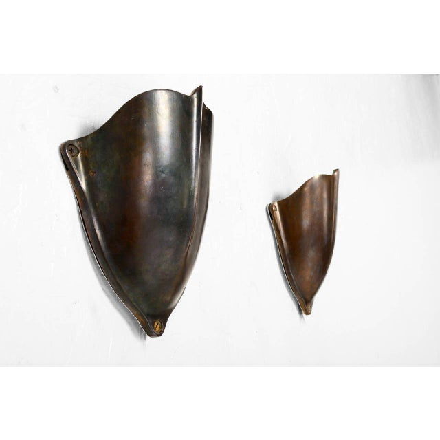 For your consideration a pair of vintage wall sconces constructed with solid brass body in the shape of a shield. Rewired...