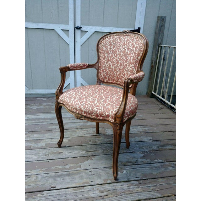 The item offered is a nice vintage Louis XV carved fruitwood hardwood French arm side chair. It is in very nice condition...
