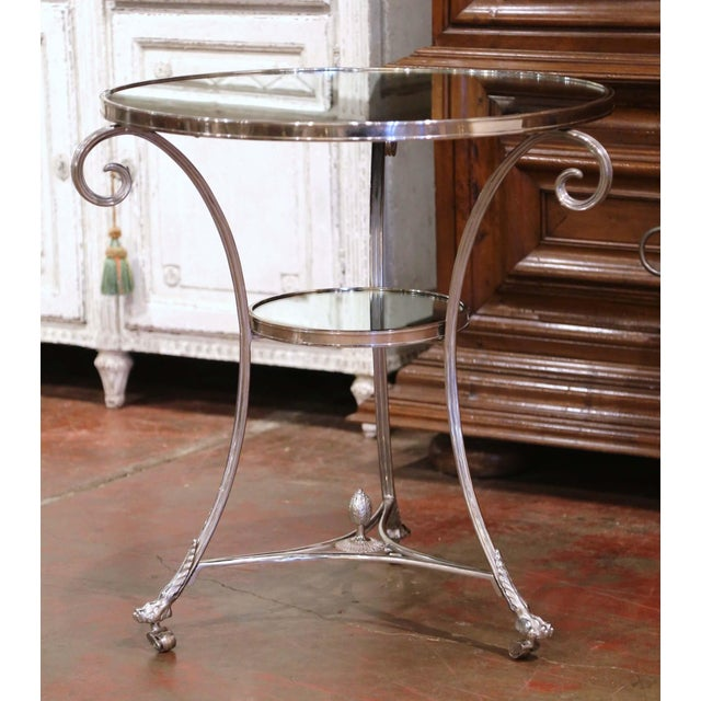 This elegant gueridon table was crafted in France, circa 1980. Round in shape and supported by three scrolled legs ending...