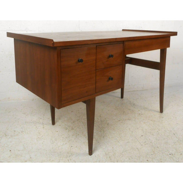 Vintage-modern American made desk featuring beautiful walnut grain and a finished back, includes sculpted walnut desk...