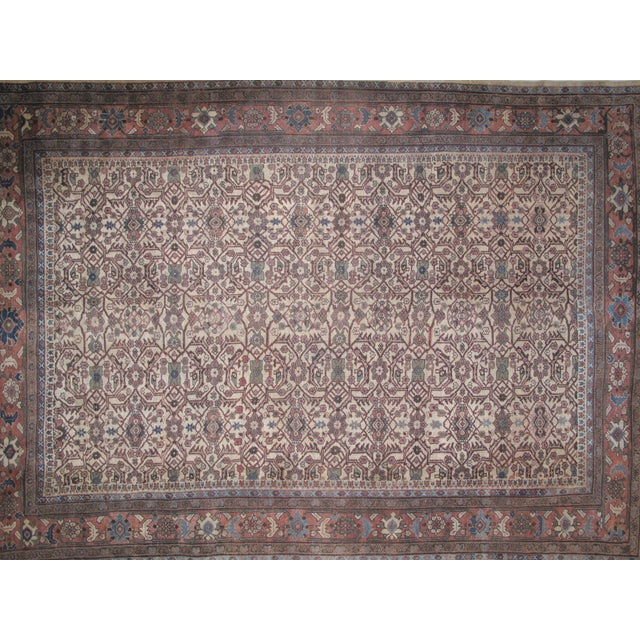 Wool pile hand woven antique beige Persian Sultanabad carpet with age related wear.